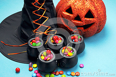 Halloween witch cauldrons full of candy