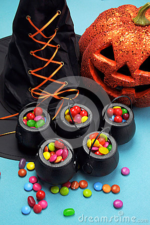 Halloween witch cauldrons full of candy - Vertical.