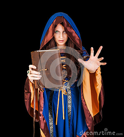 Free Halloween Witch Holding Magical Book Of Spells Making Magic Royalty Free Stock Photo - 59507015