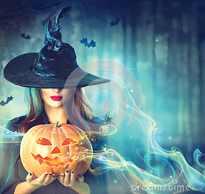 Free Halloween Witch With A Magic Pumpkin Stock Photos - 60931113