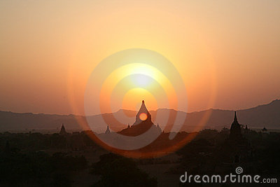 A halo of Burma sunset over Bagan pagodas