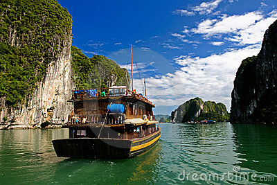 Halong Ha Long Bay and rock mountains with cloudy