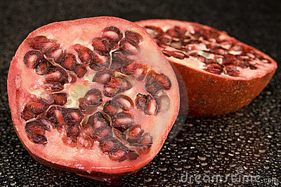 Halved pomegranate fruit