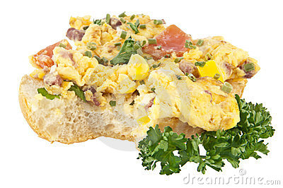 Halved roll with scrambled eggs (clipping path)