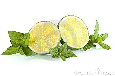 Halves of limes on mint leaves