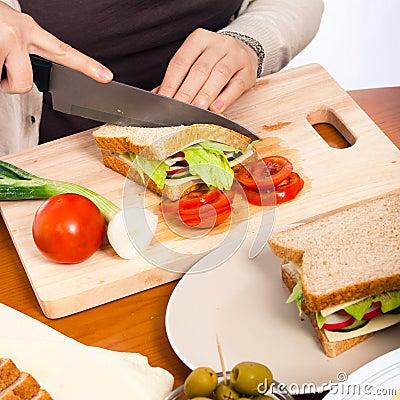Halving homemade healthy vegetable sandwich