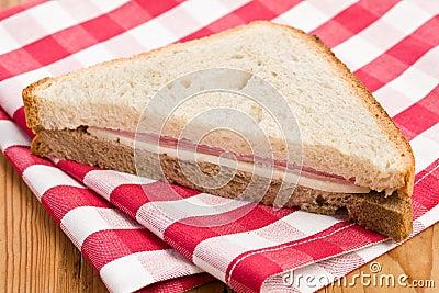 Ham sandwich on checkered napkin