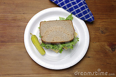 Ham Sandwich, Lettuce, Pickle on Rough Wood