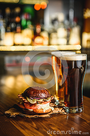 Free Hamburger And Dark Light Beer On A Pub Background. Royalty Free Stock Photos - 79680208