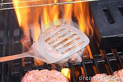 Hamburger cotti alla griglia fiamma