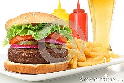 Hamburger, french fries, ketchup, mustard and beer