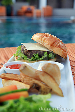 Hamburger at hotel pool