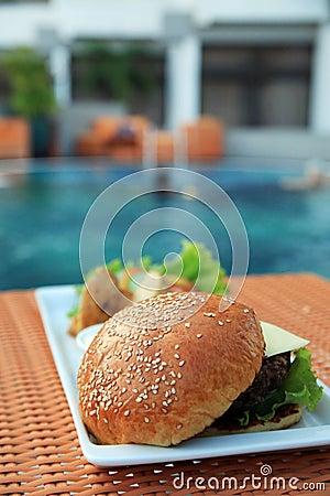 Hamburger at hotel pool