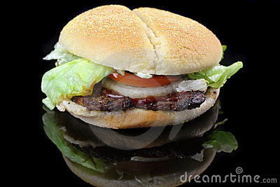 Hamburger with lettuce, tomato and onion