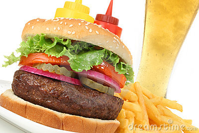 Hamburger meal with french fries and cold beer