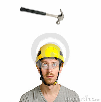 Hammer falling on bearded man with hard hat
