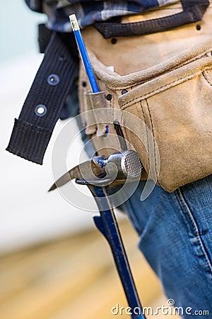 Hammer Hanging In Tool Belt Of Carpenter Royalty Free