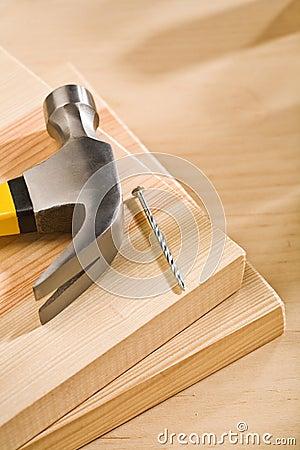Hammer with nail