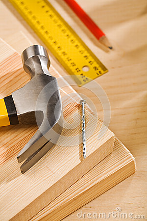 Hammer nail and ruler with pencil