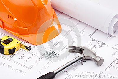 Hammer, tape measure, hard hat and nails