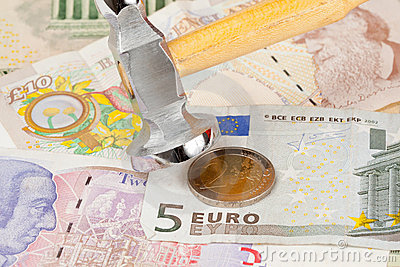 Hammer on top of Euro note