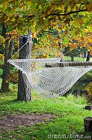 Hammock near the pond in autumn Park