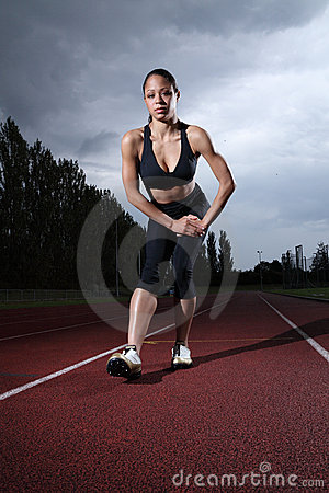 Hamstring stretch female athlete on running track