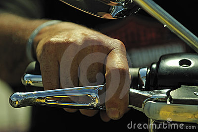 Hand on the acceleration of motor bike