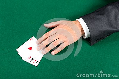 Hand with aces on the table