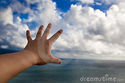 Hand in the air and touch cloud
