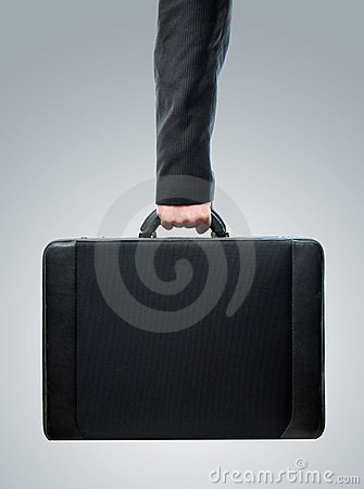 Hand and arm holding brief case