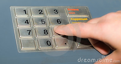 Hand and ATM keypad