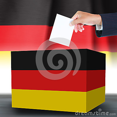 Hand with ballotand box on Flag of Germany