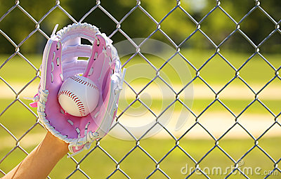 Hand of Baseball Player with Pink Glove and Ball