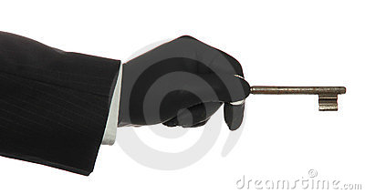 Hand with black rubber glove with old rusty key