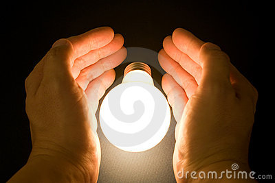 Hand and a Bright Light Bulb