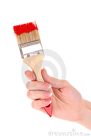 Hand with brush and red paint isolated