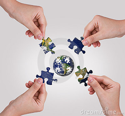 Free Hand Building Puzzle Globe. Royalty Free Stock Photo - 20291585
