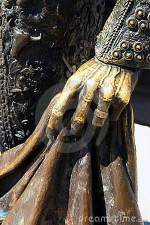 Hand on bullfighter statue