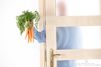 Hand with carrots