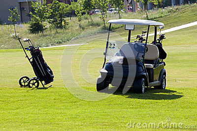 Hand cart with golf clubs