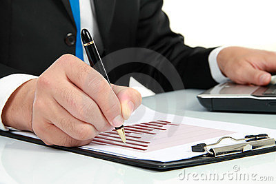 Hand checking at diagram on financial report