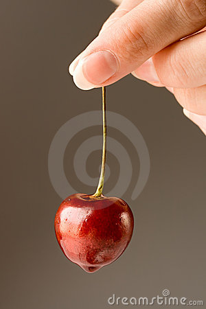 Hand with a cherry