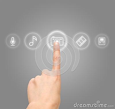Hand choosing photo camera symbol from media icons