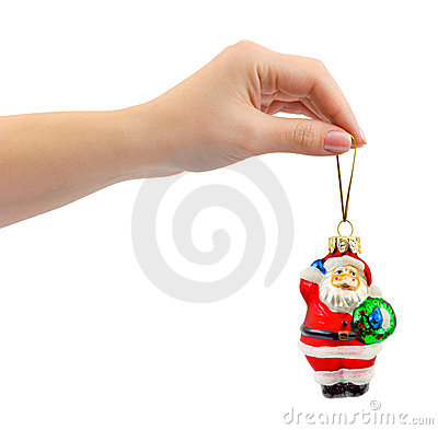 Hand and christmas toy Santa