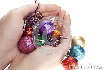 Hand and christmas toys