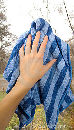Hand with clean dishrag