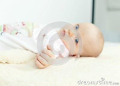 Hand closeup of a tiny baby