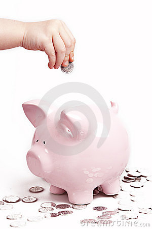 Hand coins piggy bank