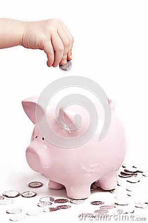 Hand coins piggy bank